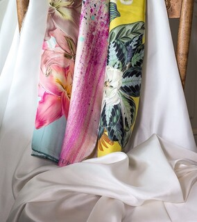 Plain white and printed silk textile from Aria Creative International